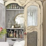 An old cabinet redefined as the bar can be a good budget option. It also adds to the understated elegance of the room without using too much of the space.