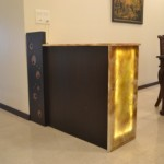 This bar with an Onyx top was designed for an apartment in South Mumbai. The counter acts as a room divider between the living and dining area