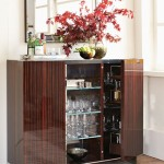 Bar is not a showcase to display your each and every bottle and glass hence a good storage helps in keeping the space clutter free. It's all about the artful display of things which add character to the space.