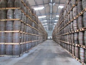Warehouse filled with whisky laden barrels